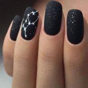 Black glitter nails with art of white stars...