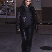 Lady in leather: Kim Kardashian couldn't help a late-night craving as she st...